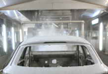 When cars are spray painted, a small amount is lost in the process and falls into a treatment vat